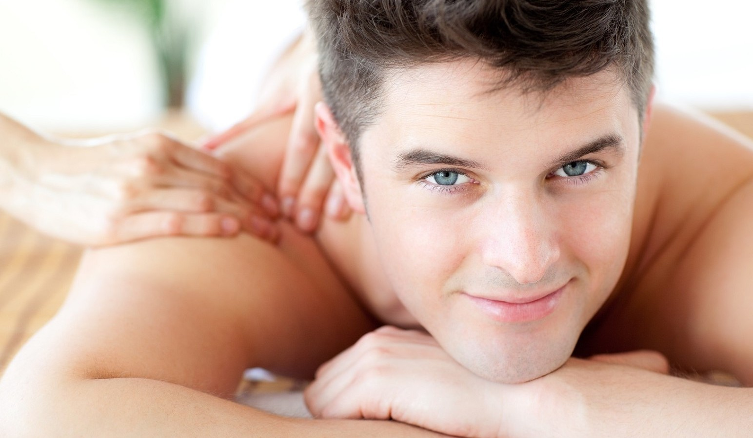 Beautiful man enjoying a back massage